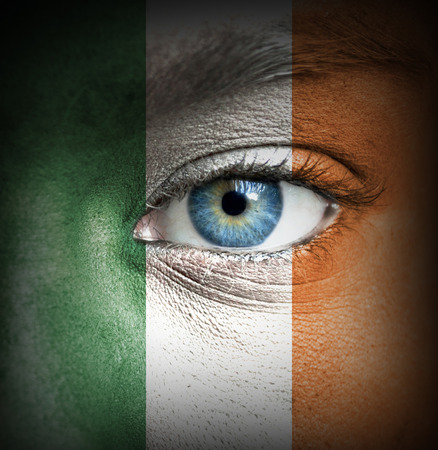 Human face painted with flag of Ireland photo