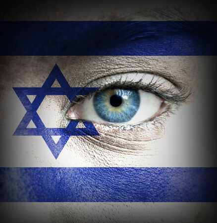 Human face painted with flag of Israel photo