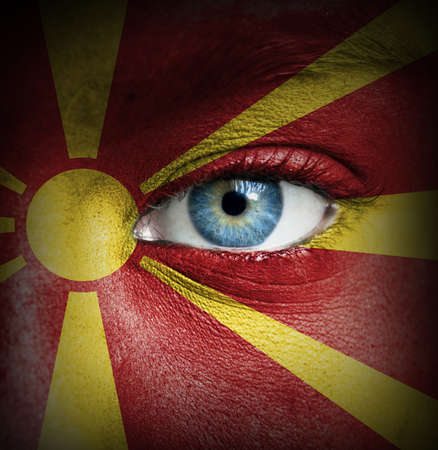 Human face painted with flag of Macedonia