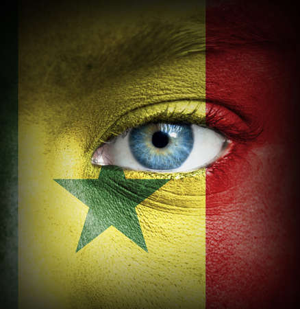 Human face painted with flag of Senegal photo