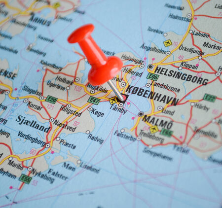 Close up of Copenhagen map with red pin - Travel concept photo