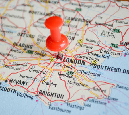 Close up of London map with red pin - Travel concept photo