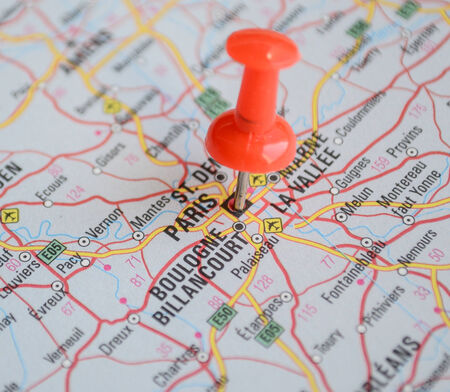Close up of Paris map with red pin - Travel concept photo
