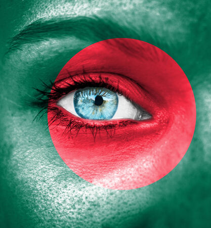 Woman face painted with flag of Bangladesh Stock Photo