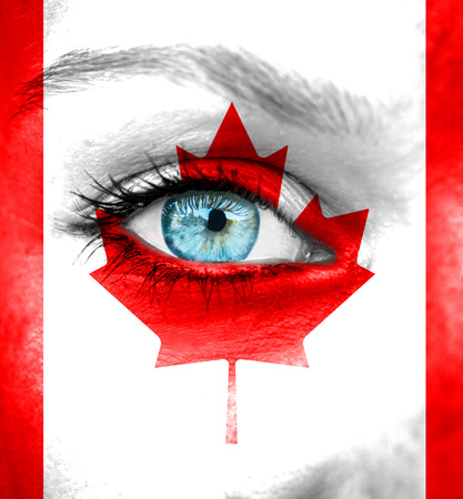 Woman face painted with flag of Canada photo