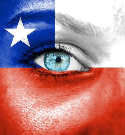 Woman face painted with flag of Chile photo