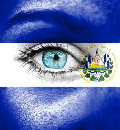 el salvador flag: Woman face painted with flag of El Salvador Stock Photo