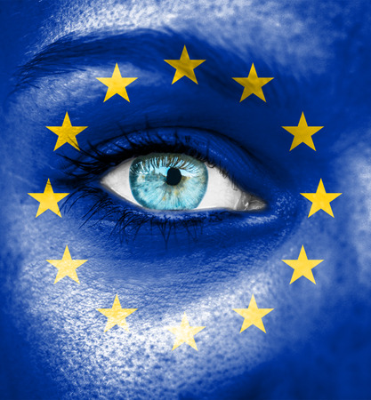 Woman face painted with flag of European Union photo