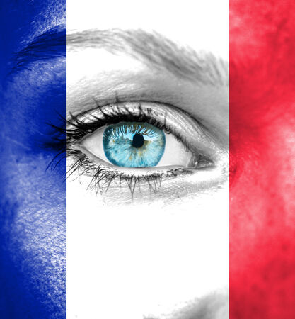 Woman face painted with flag of France photo