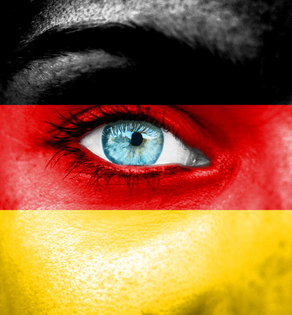 Woman face painted with flag of Germany photo