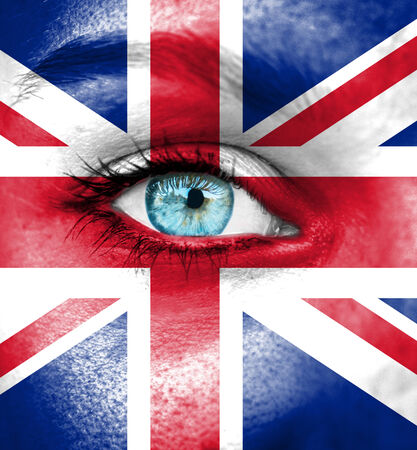 Woman face painted with flag of Great Britain photo