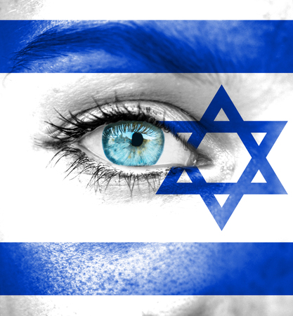 Woman face painted with flag of Israel photo