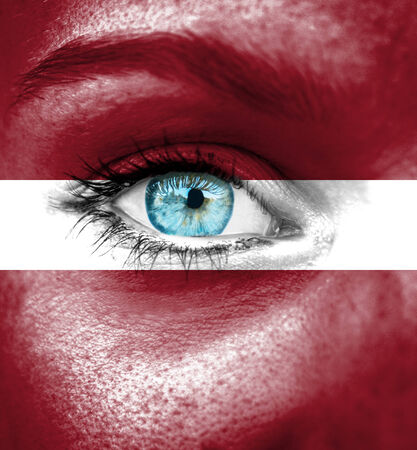 latvia girls: Woman face painted with flag of Latvia
