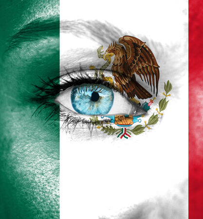Woman face painted with flag of Mexico photo