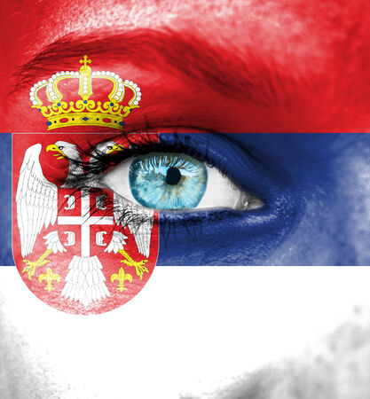 Woman face painted with flag of Serbia photo