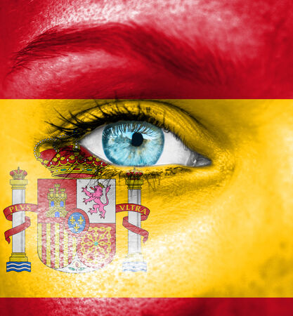 Woman face painted with flag of Spain photo