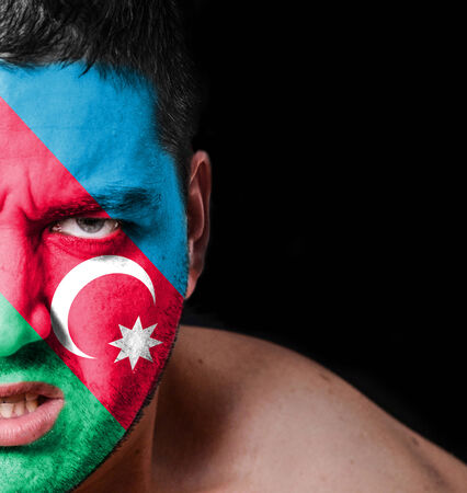 azerbaijanian: Portrait of angry man with painted flag of Azerbaijan
