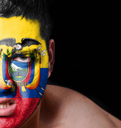 Portrait of angry man with painted flag of Ecuador photo