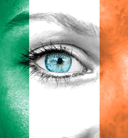 Woman face painted with flag of Ireland photo