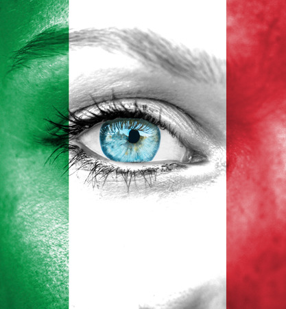 Woman face painted with flag of Italy photo