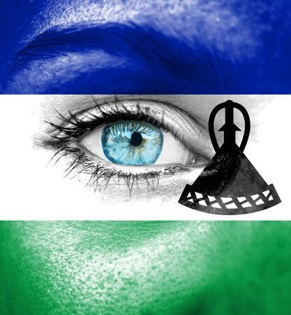 lesotho: Woman face painted with flag of Lesotho Stock Photo