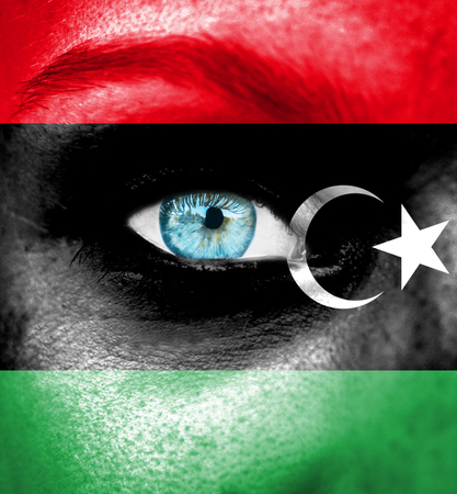 libyan: Woman face painted with flag of Libya