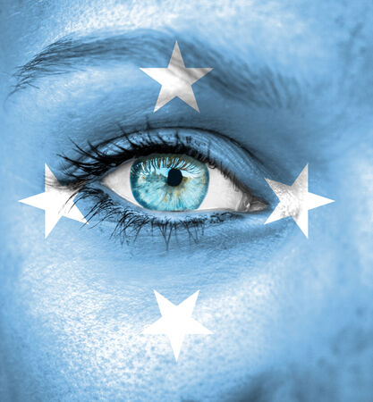 micronesia: Woman face painted with flag of Micronesia Stock Photo