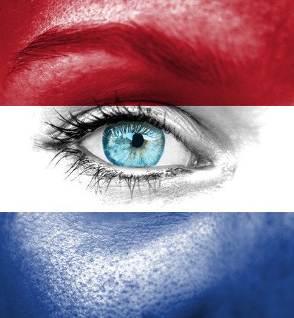 follower: Woman face painted with flag of Netherlands Stock Photo