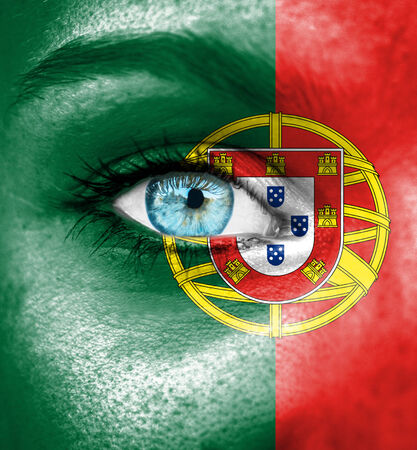 portugal flag: Woman face painted with flag of Portugal