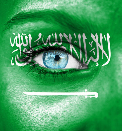 Woman face painted with flag of Saudi Arabia photo