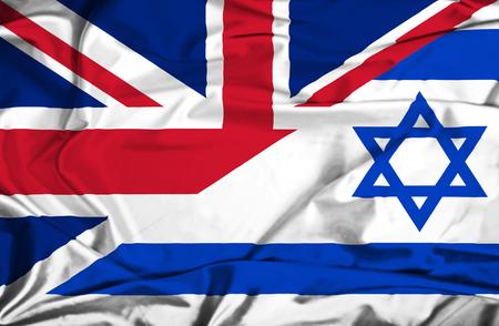 Waving flag of Israel and UK Stock Photo