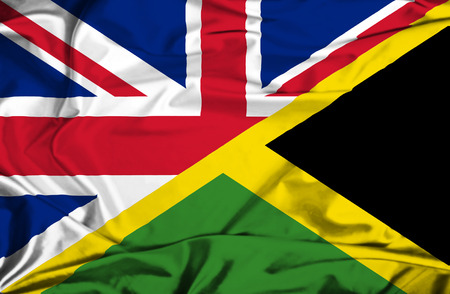 Waving flag of Jamaica and UK photo