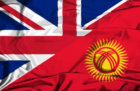 kyrgyzstan: Waving flag of Kyrgyzstan and UK Stock Photo