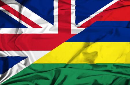 Agitant un drapeau de l'île Maurice et au Royaume-Uni Banque d'images - 27768809