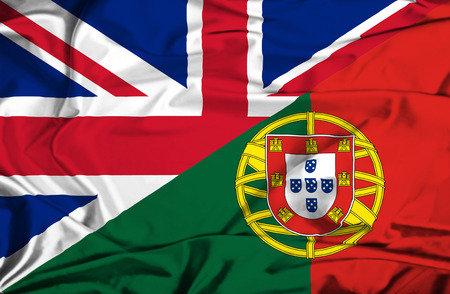 portugese: Waving flag of Portugal and UK Stock Photo