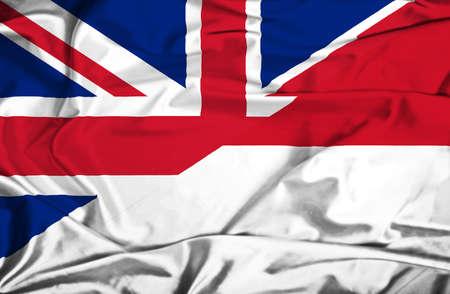 Waving flag of Monaco and UK photo