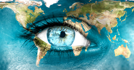 futuristic eye: Planet earth and blue human eye - Elements of this image furnished by NASA