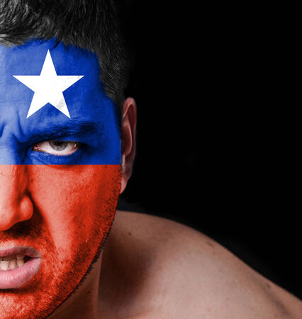 Portrait of angry man with painted flag of Chile photo