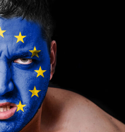 Portrait of angry man with painted flag of European Union photo