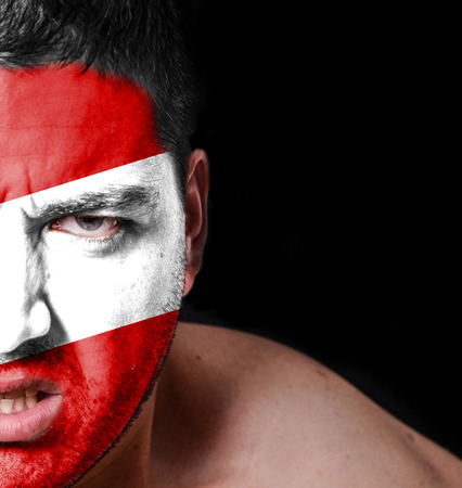 Portrait of angry man with painted flag of Peru photo
