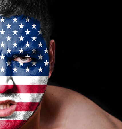 Portrait of angry man with painted flag of United States of America photo