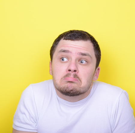 insensitive: Portrait of funny cluelles man against yellow background