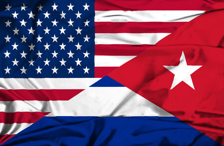 Waving flag of Cuba and USA photo