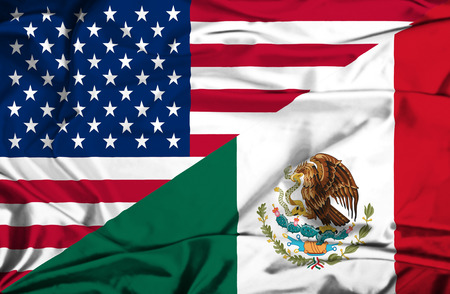 Waving flag of Mexico and USA photo