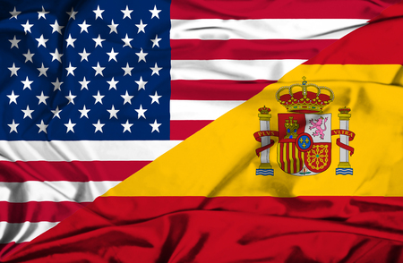 Waving flag of Spain and USA Stock Photo