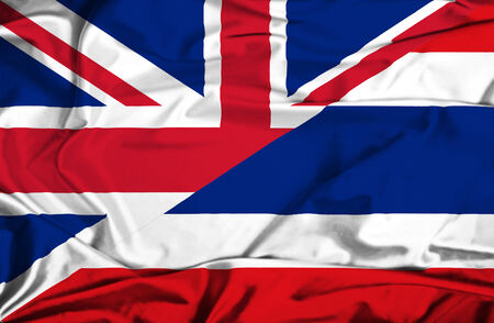 Waving flag of Thailand and UK photo