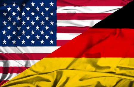 ドイツとアメリカの旗を振っています。 写真素材
