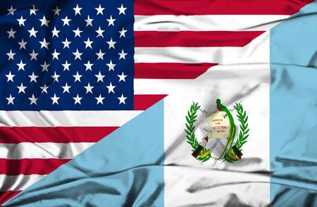 Waving flag of Guatemala and USA photo