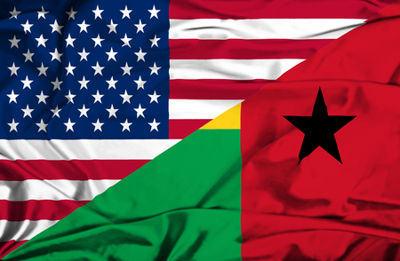 guinea bissau: Waving flag of Guinea Bissau and USA