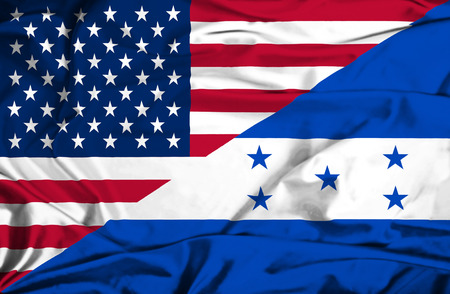 Waving flag of Honduras and USA photo